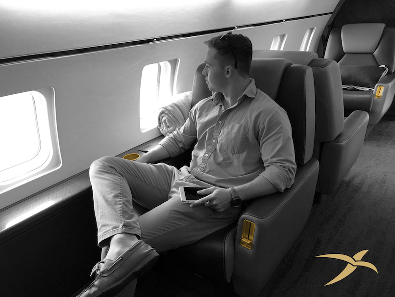 Young man on private jet